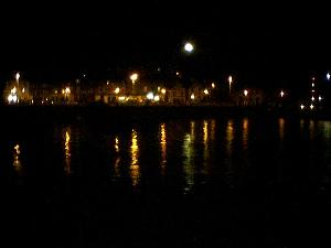 Looking at the quality fish and chip shop over the  harbour.  At night.  ;-)