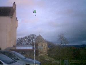 After several unsuccessful attempts to flnd wind for kite-flying, the mini kite took off today. Very cool indeed.