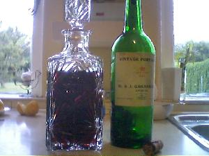 This 1963 bottle of Graham vintage port wine was a very nice present to my dad. This afternoon we decanted it, and tonight we thoroughly enjoyed drinking it. The debris (it requires a much more substantial word then sediment) left in the bottle was incredible. Look carefully at the picture.
